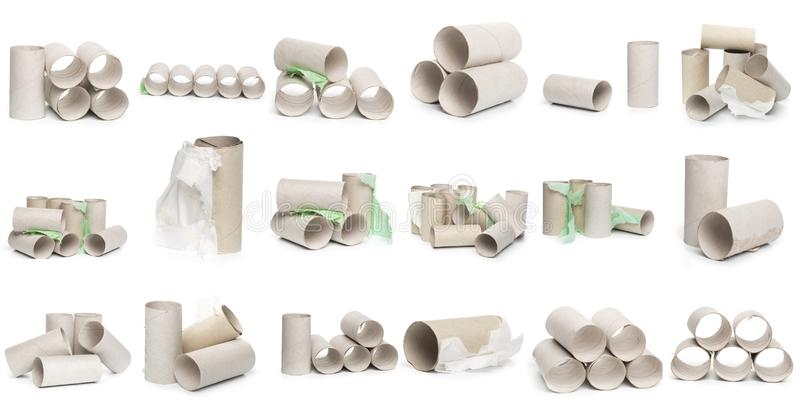 Una selección de tubos del papel higiénico de la cartulina en diversos arreglos aislados en un fondo blanco imagen de archivo libre de regalías