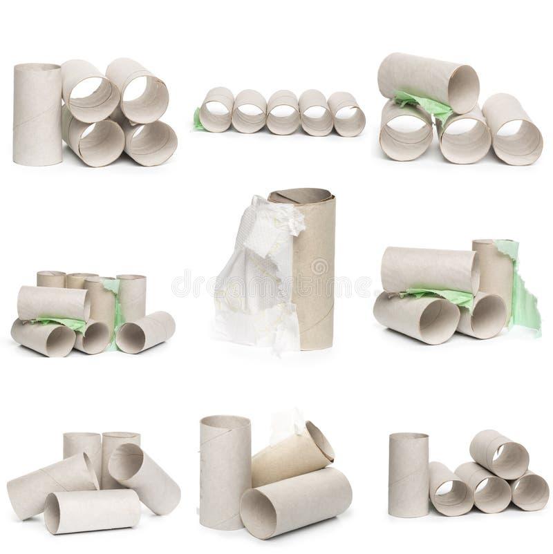 Una selección de tubos del papel higiénico de la cartulina en diversos arreglos aislados en un fondo blanco imágenes de archivo libres de regalías