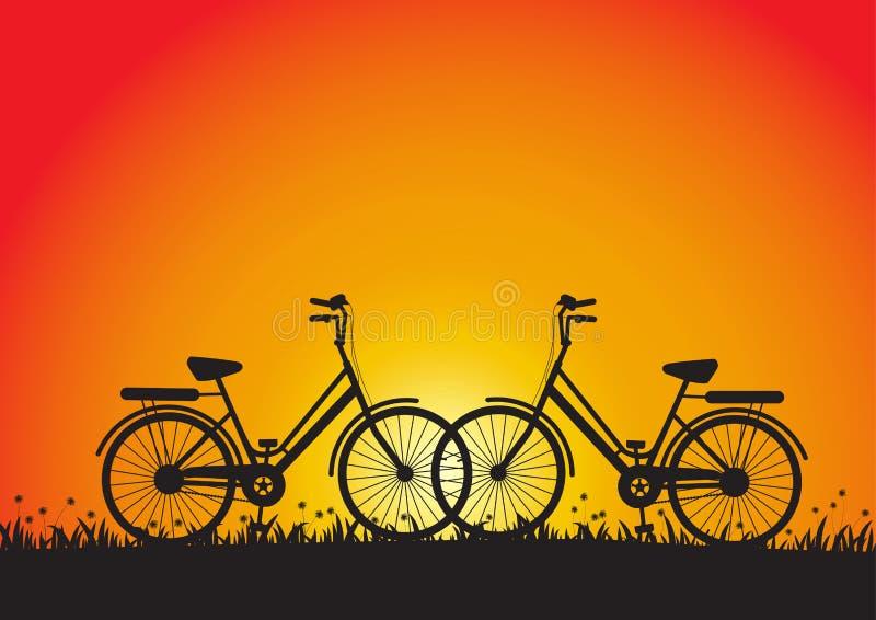 Una siluetta di due biciclette durante il tramonto in prato illustrazione vettoriale