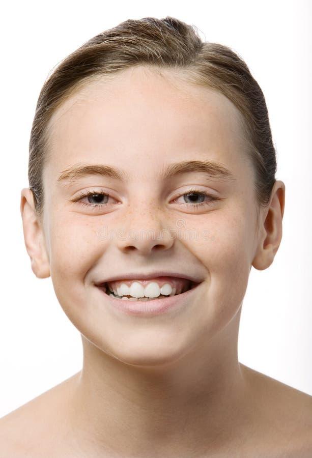 Una sonrisa adolescente imagenes de archivo