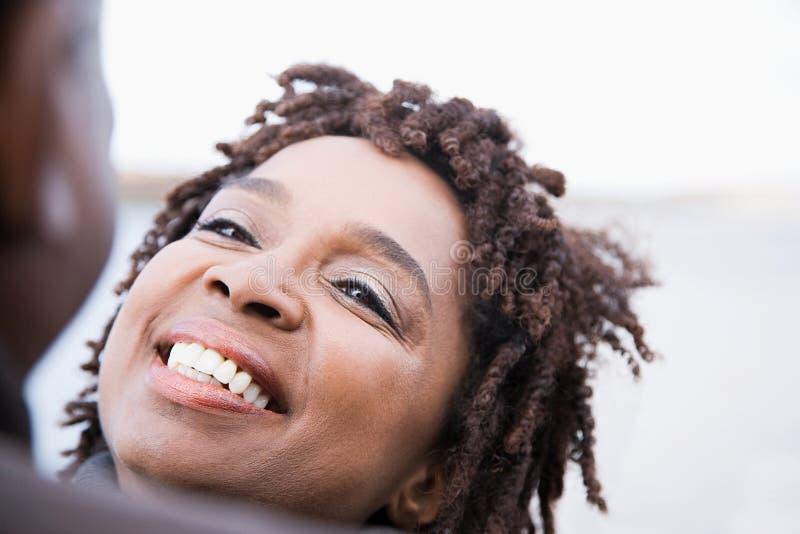 Una sonrisa de la mujer foto de archivo libre de regalías
