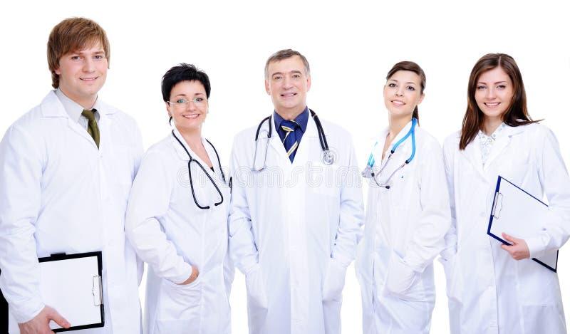 Una squadra di diversità di riuscito medico felice cinque fotografia stock