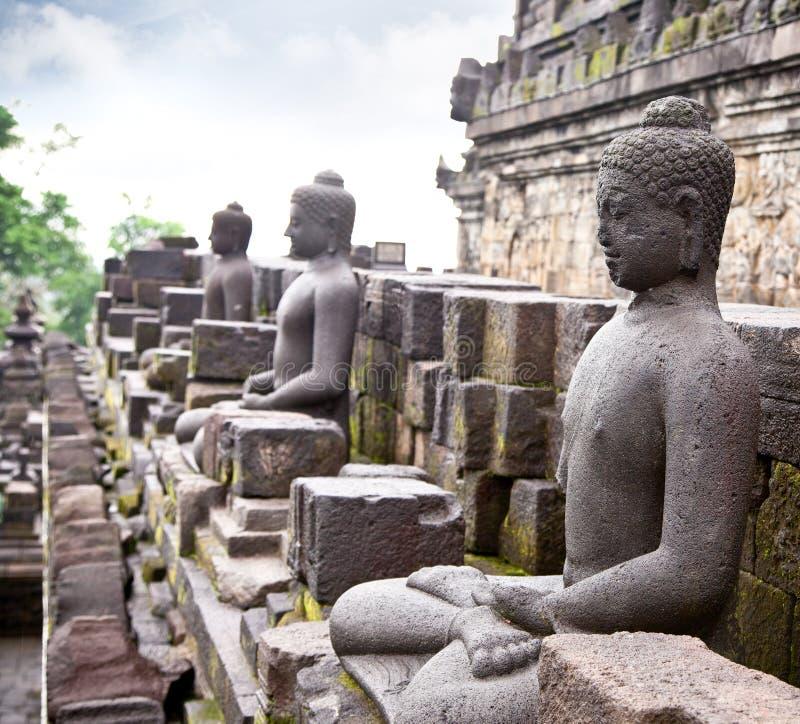 Una statua del Buddha da Borobudur su Java, Indonesia. fotografia stock libera da diritti