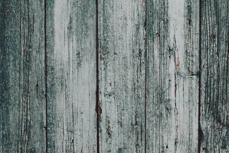 Una superficie de madera gris-verde sucia Tableros dilapidados de madera grises Fondo de madera de la textura del tabl?n Tabla de fotos de archivo libres de regalías