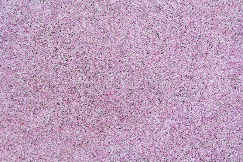 Una superficie di gomma rosa della briciola come struttura, fondo fotografie stock