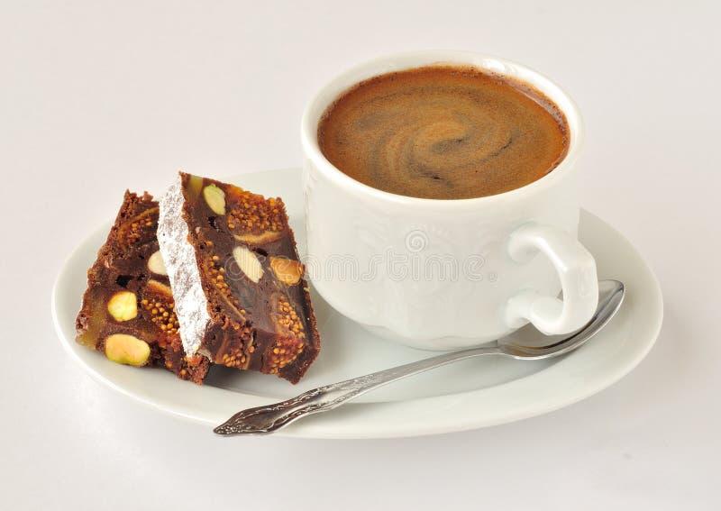 Una taza de café con Panforte fotografía de archivo libre de regalías