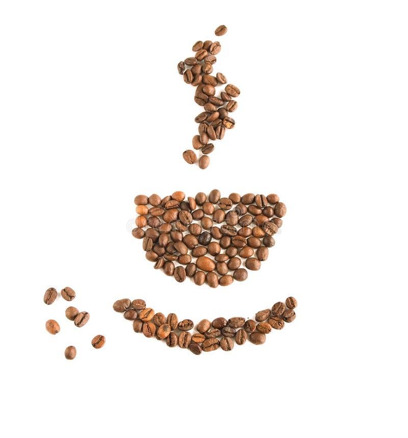 Una taza de granos de café foto de archivo
