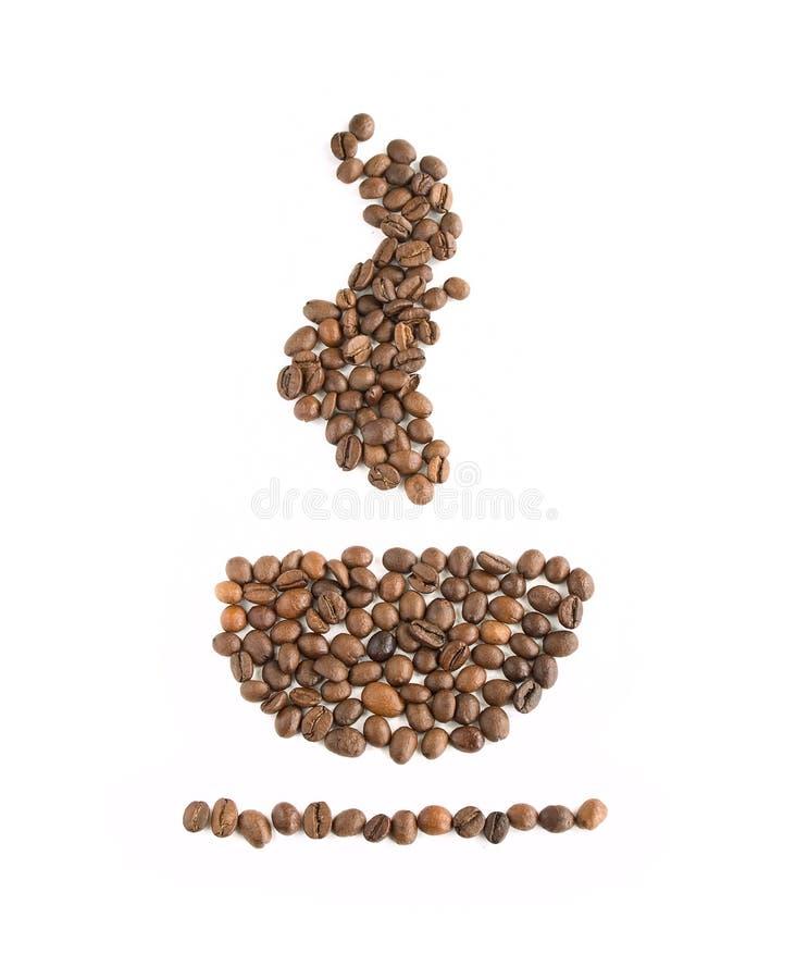 Una taza de granos de café imagen de archivo