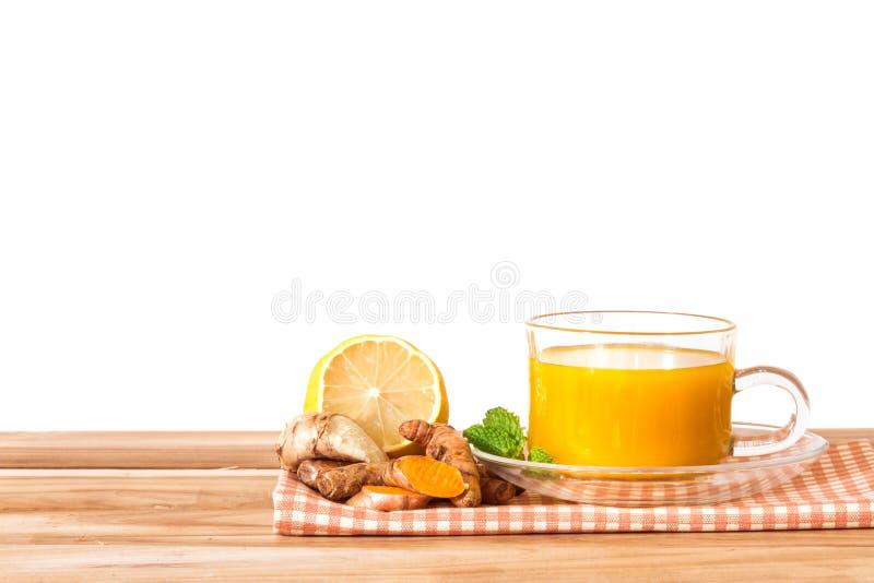 una taza del té de la cúrcuma, ventajas para reduce la inflamación, hígado fotografía de archivo libre de regalías