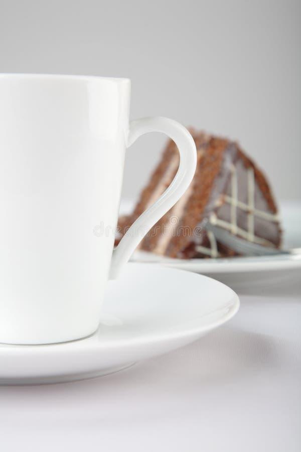 Una tazza di tè e della torta fotografia stock