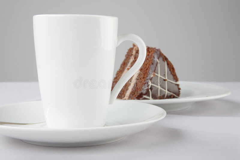 Una tazza di tè e della torta fotografie stock libere da diritti