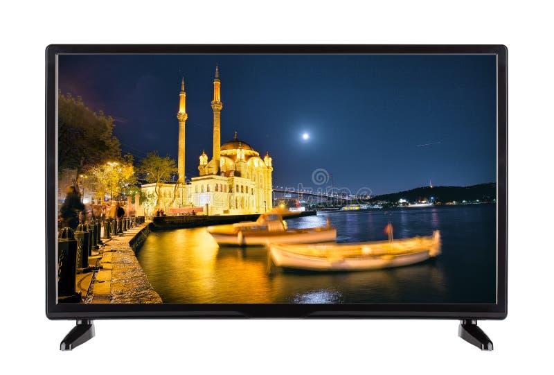 Una televisión de alta definición moderna con la imagen de la noche q foto de archivo