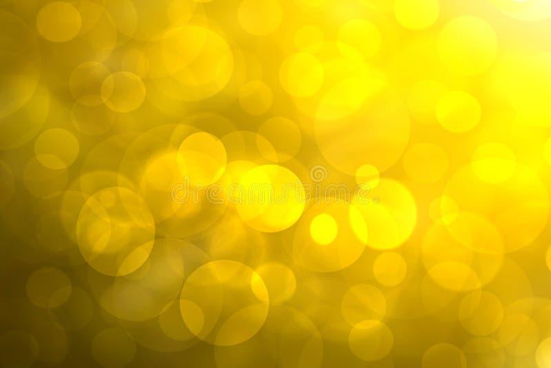 Una textura amarilla de oro del fondo de la pendiente del extracto festivo con los c?rculos defocused del bokeh de la chispa del  imagen de archivo libre de regalías