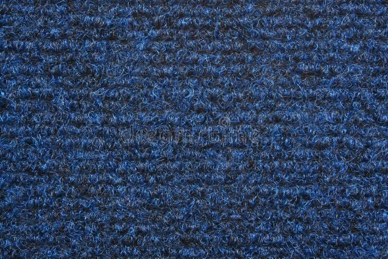 Una textura azul de la alfombra imagenes de archivo