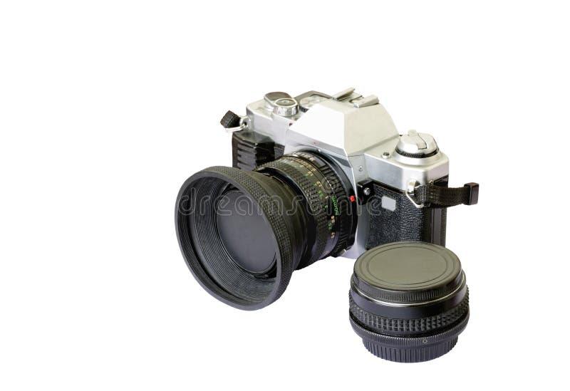 Una vecchia macchina fotografica analog di modello e una carica immagini stock