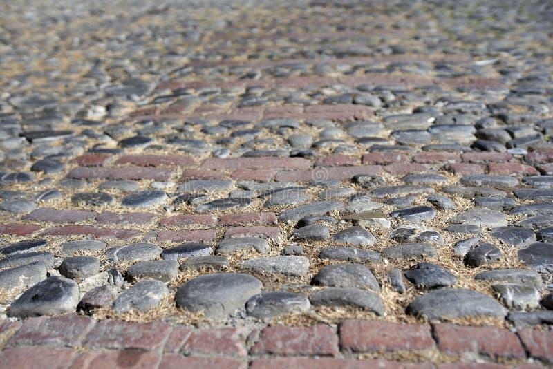 Una via pavimentata in pietra fotografia stock