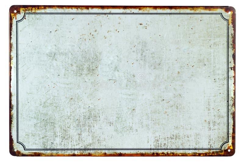 Una vieja muestra oxidada en blanco del metal foto de archivo libre de regalías