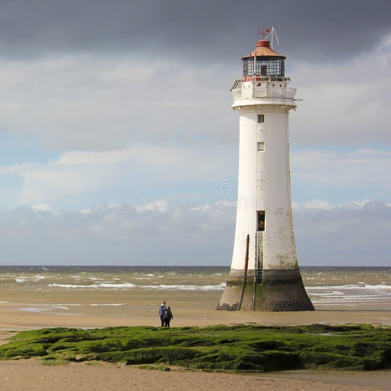 Una vista di nuova Brighton, o roccia della pertica, faro fotografia stock libera da diritti
