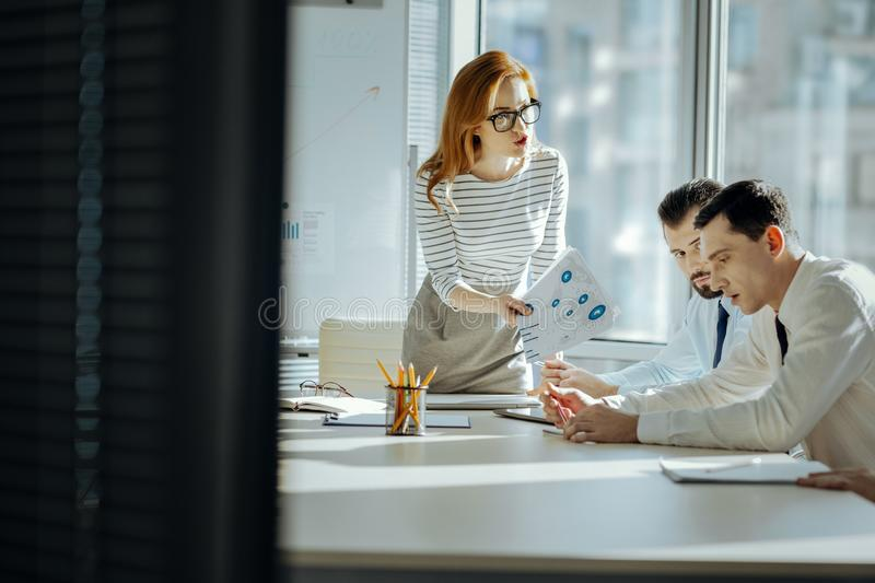 Strict boss scolding employees for poor performance stock photos