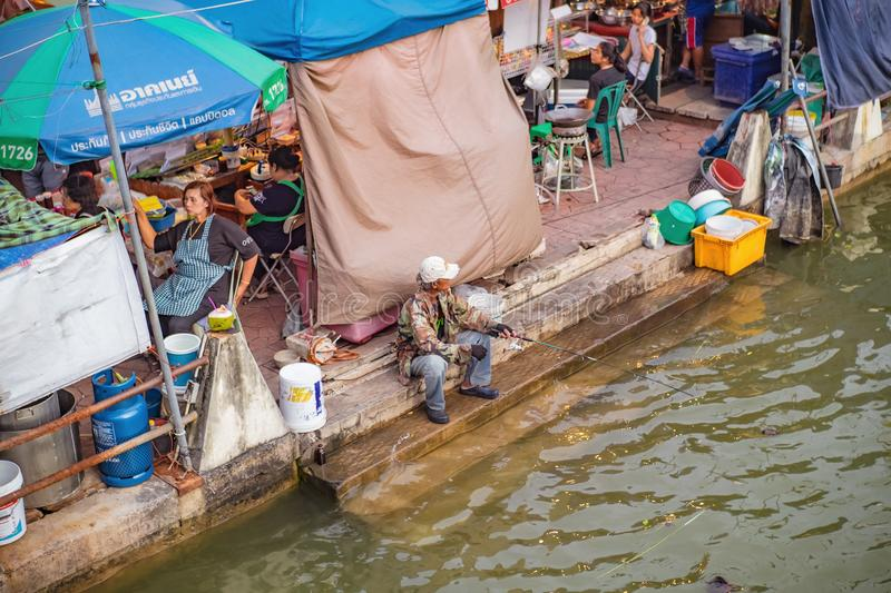 Unacquainte thai people Fishing on the river in Amphawa Floating market in holiday time. Samutsongkhram/Thailand - 16 September 2017 :Unacquainte thai people royalty free stock images