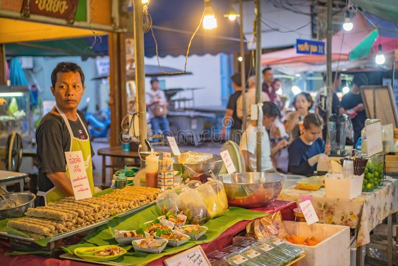 Unacquainte thai people Selling thai street Food in Amphawa Floating market in holiday time. Samutsongkhram/Thailand - 16 September 2017 :Unacquainte thai people stock photo