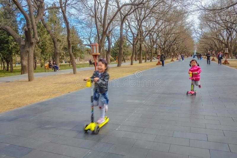Unacquainted chinese Childen Playing in Temple of Heaven park or Tiantan in Chinese Name in beijing city,China travel stock images