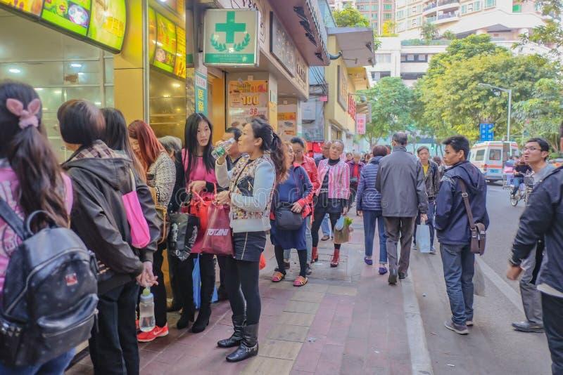 Unacquainted Chinese People walking in Shang Xia jiu walking street in Guangzhou city.Shang xia jiu walking street stock images
