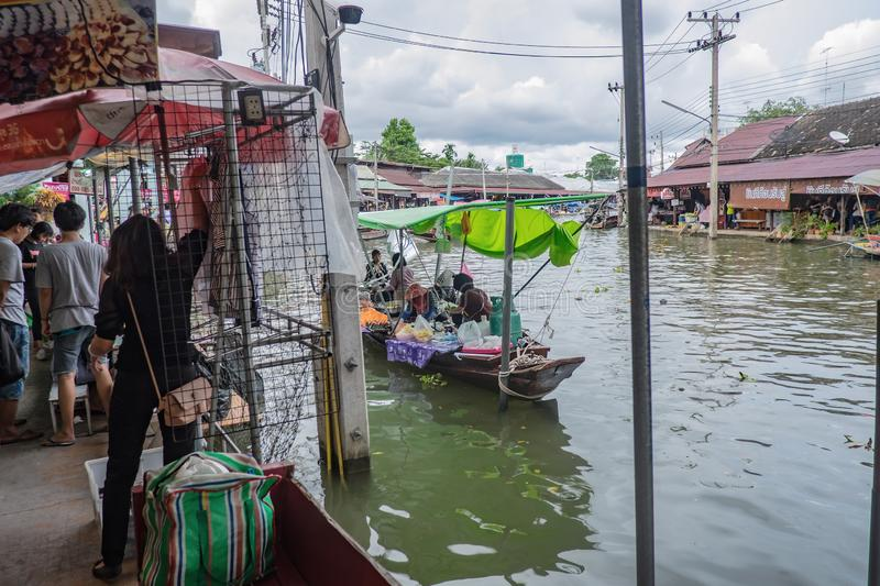 Unacquainted Thai people and tourists come to visit Amphawa Floating market in holiday time. Samutsongkhram/Thailand - 16 September 2107 : Unacquainted Thai stock image
