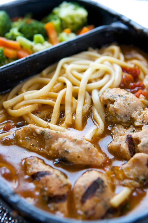 Unappealing tv dinner of chicken stock photo