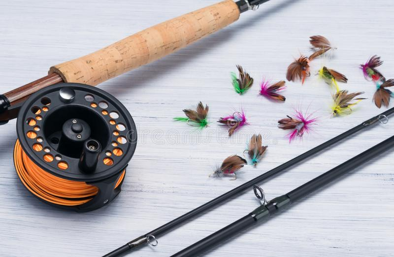 Unassembled fishing rod with bait lies on a light background of the table, close-up royalty free stock images