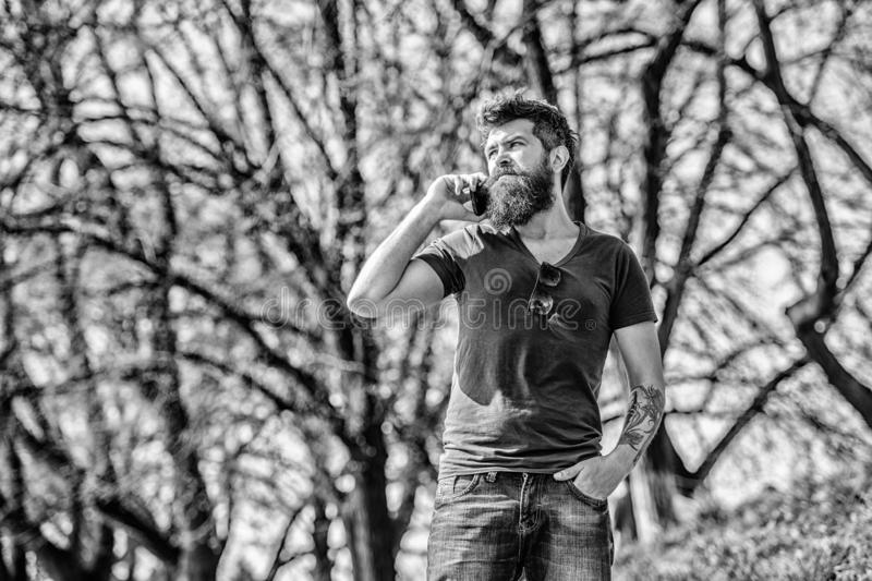 Unavailable at the moment. Hipster with beard using mobile phone. Man with beard calling. Bearded man call cell phone royalty free stock photo