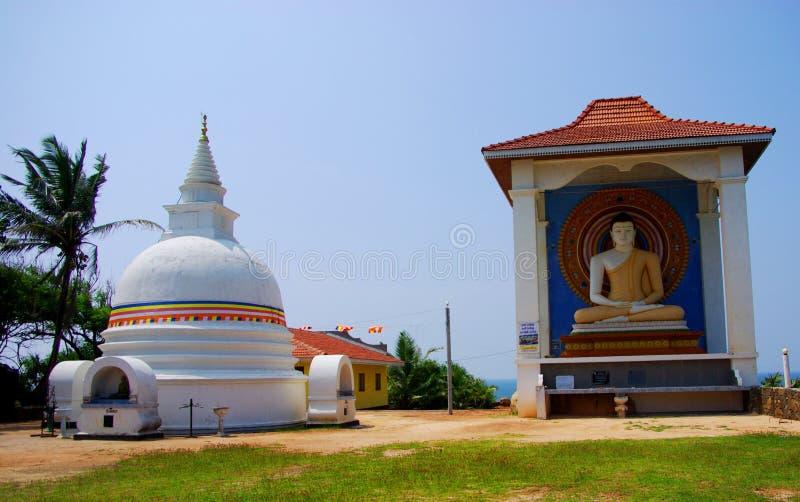 Unawatuna Beach Temple. The dagoba and sitting Buddha at the summit of the temple at Unawatuna Beach (Sri Lanka royalty free stock photography