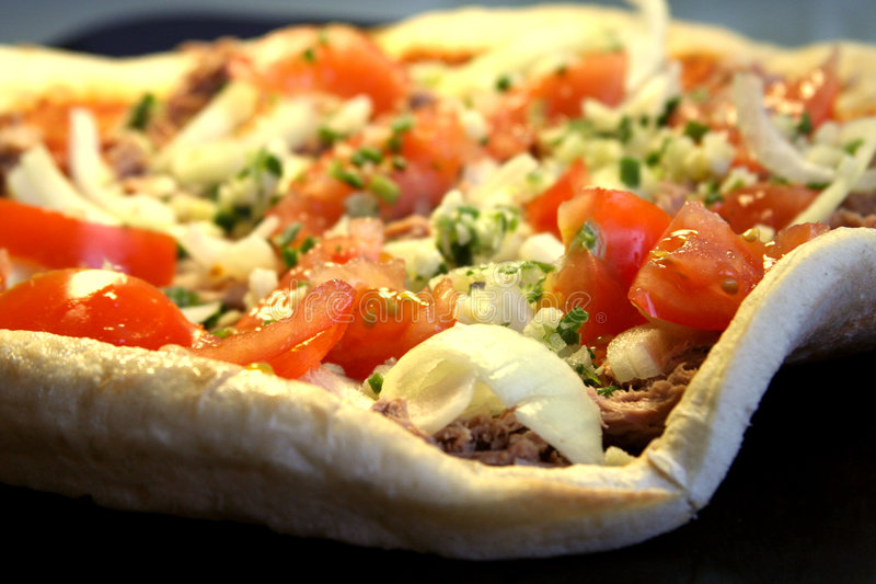 Unbaked pizza stock photography