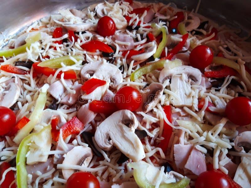 Close up Homemade uncooked  italian pizza. royalty free stock photo