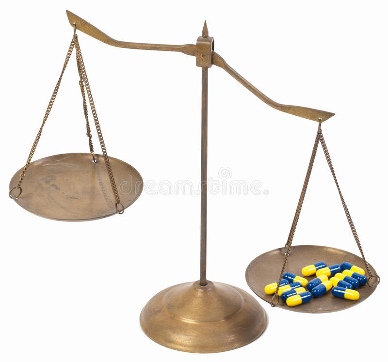 Unbalance of drug golden brass scales of justice stock photos