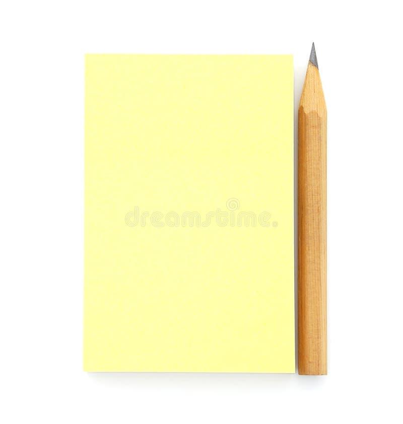 Unbelegte gelbe Post-Itanmerkung lizenzfreie stockfotografie