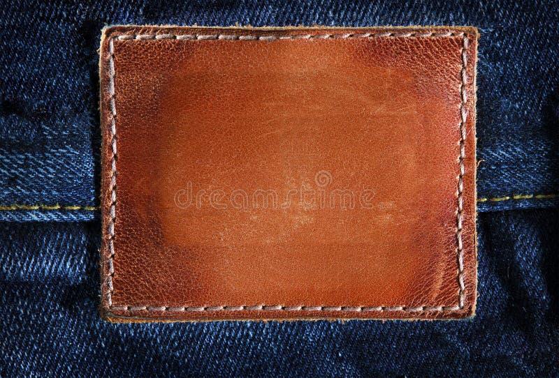 Unbelegte lederne Jeans lizenzfreies stockbild