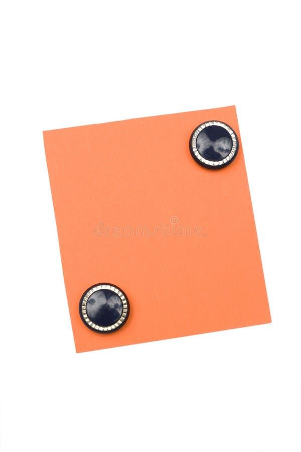 Unbelegte Orange Anmerkung Mit Magneten Lizenzfreie Stockfotos