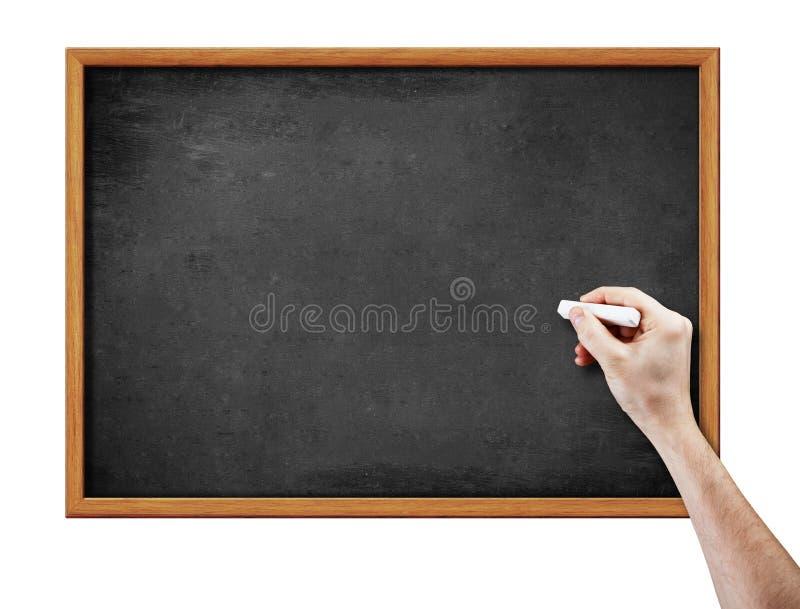 Unbelegter schwarzer Vorstand und Hand mit Stück Kreide stockfotos