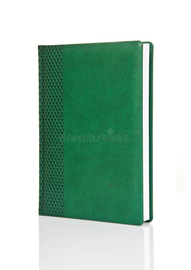 Unbelegtes grünes Buchbuch mit Verzierung lizenzfreies stockbild