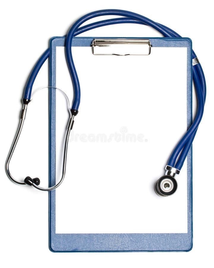 Unbelegtes Klemmbrett mit Stethoskop lizenzfreies stockbild