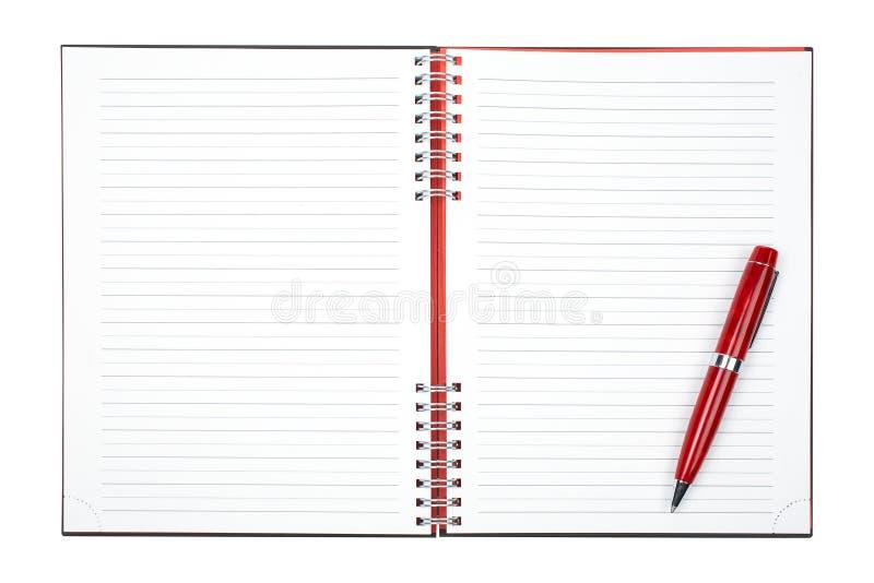 Unbelegtes Notizbuchblatt mit Feder stockfotos