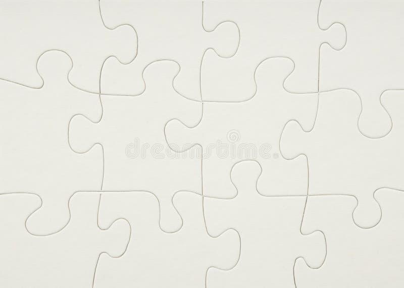Unbelegtes weißes Puzzlespiel stockbild