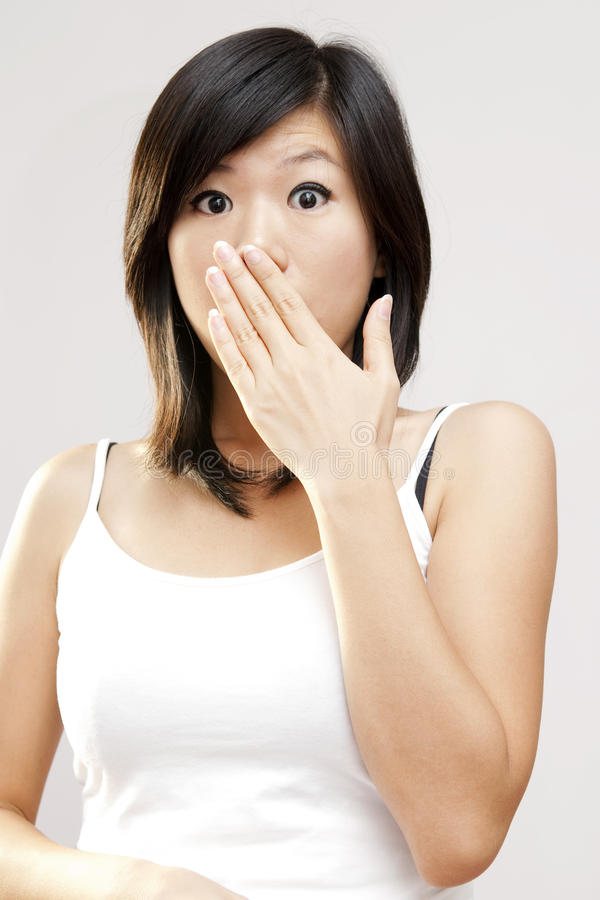 Unbelievable!. Shocked woman covering her mouth by hand royalty free stock photo