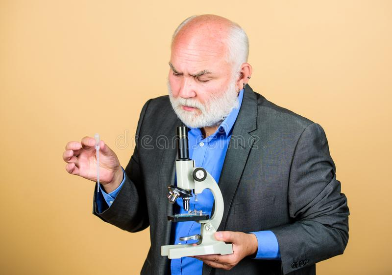 It is unbelievable. mature bearded teacher with microscope. senior man biologist. university professor. knowledge and. Wisdom. biology education. science lab royalty free stock photo