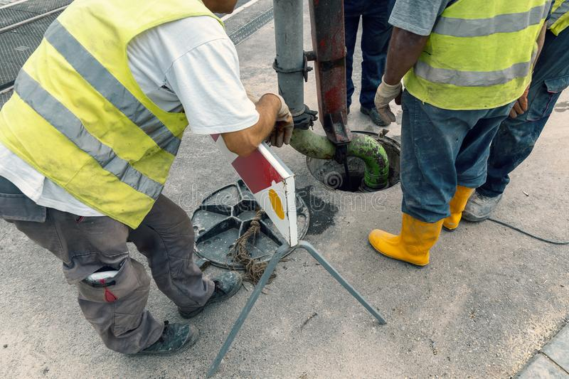 Unblock a drain 2. Unblock a drain. Sewer Lines Cleaning Service. Cleaning blocked sewer. Color effect stock photo