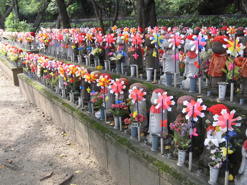 Unborn Children Garden at the cemetery of Japanese temple. Unborn Children Garden at the cemetery of a Buddhist temple, Tokyo, Japan. Rows of stone statues of stock image