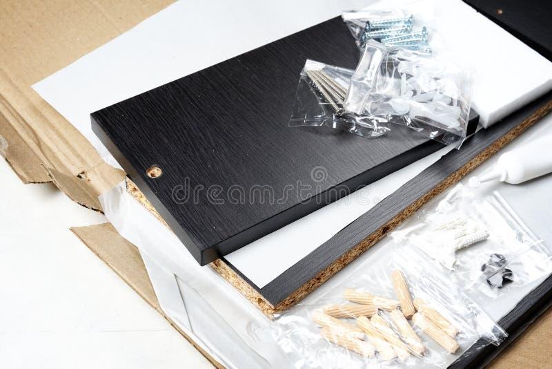 Unboxing la mobilia fotografie stock