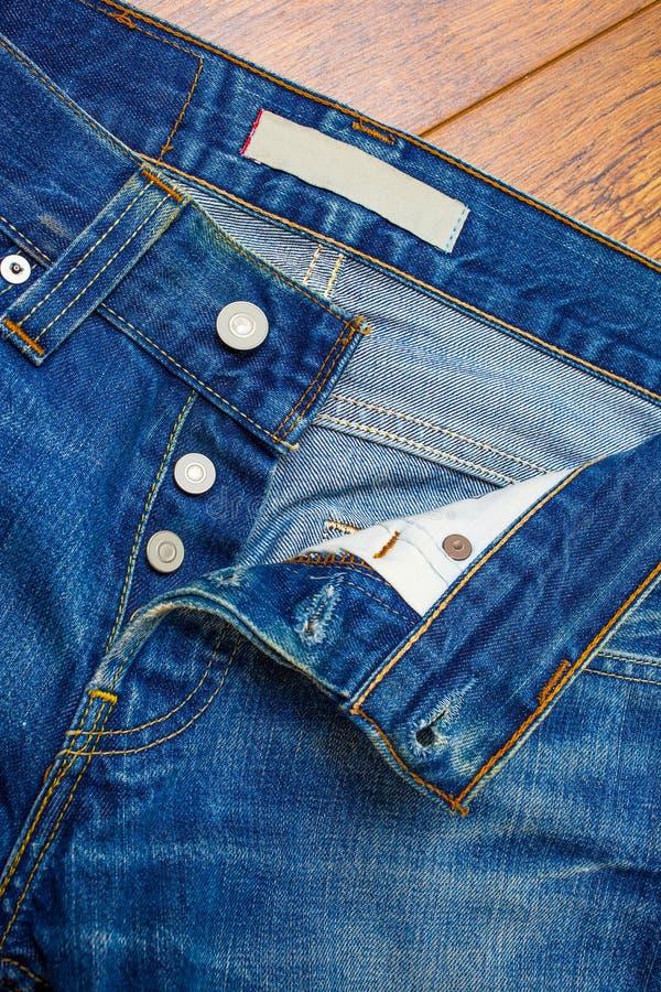 unbuttoned jeans royaltyfria foton