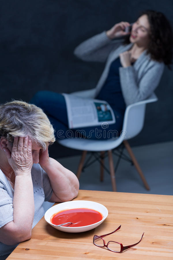 Uncaring home caregiver. Senior can not stand uncaring home caregiver royalty free stock images